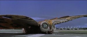 The full-grown Mothra puts down on a landing field