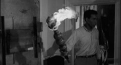 Drastic measures: Ben (Duane Jones) wields a flaming torch inside the farmhouse in George A. Romero's Night of the Living Dead (1968)
