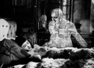 The hunter's ghost (Jacques Tati) visits Sylvie (Odette Joyeux) at night, an in-camera effect in Claude Autant-Lara's Sylvie et le fantôme (1946)