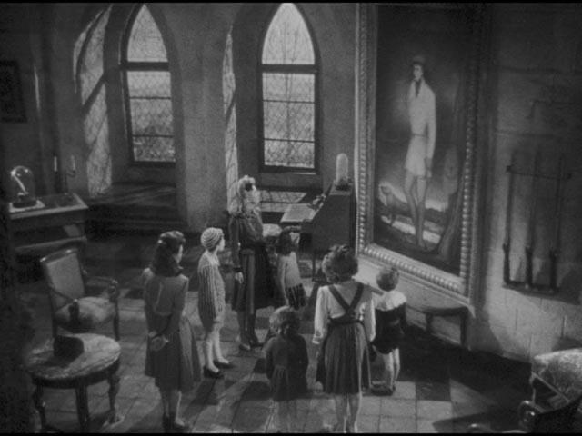 Sylvie (Odette Joyeux) tells the tragically romantic story behind the portrait of the hunter in Claude Autant-Lara's Sylvie et le fantôme (1946)