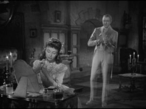 The ghost (Jacques Tati) of her grandmother's lover is drawn to a romantic girl (Odette Joyeux) in Claude Autant-Lara's Sylvie et le fantôme (1946)