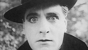 Louis Willoughby as Isoldi Keene, a sinister Mormon Elder with hypnotic powers in Trapped By the Mormons (1922)