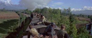 The prisoners take control of the train in Von Ryan's Express (1965)