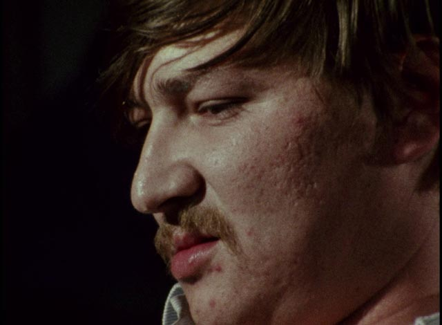 Baal (Rainer Werner Fassbinder) sneers at the world with contempt in Volker Schlondorff's Baal (1970)
