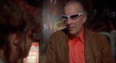 Christopher Lee tries unsuccessfully to hide behind his shades in a supporting role in Philippe Mora's Howling II (1985)