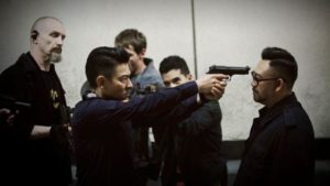 Officer Cheung (Andy Lau) loses patience with psychotic villain Peng Hong (Wu Jiang) in Herman Yau's Shock Wave (2017)