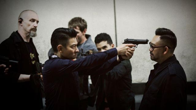 Officer Cheung (Andy Lau) loses patience with psychotic villain Peng Hong (Wu Jiang) in Herman Yau's Shock Wave (2017)