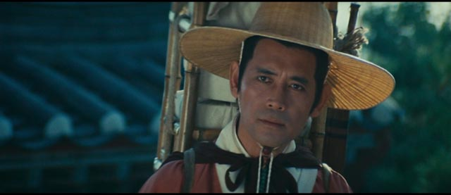 Ho (Shih Chun) is curious but passive in his encounters with ghosts and demons in King Hu's Legend of the Mountain (1979)