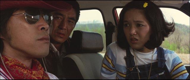 Kin'ya (Tetsuya Takeda), Yûsaku (Ken Takakura) and Akemi (Kaori Momoi) meet by chance on the road in Yoji Yamada's The Yellow Handkerchief (1977)
