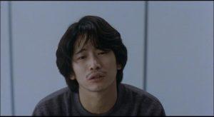 Amnesiac medical student Mamiya (Masato Hagiwara) spreads murderous chaos in Kiyoshi Kurosawa's Cure (1997)