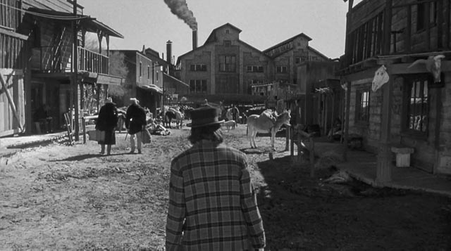 William Blake (Johnny Depp) walks towards the gates of Hell in the town of Machine in Jim Jarmusch's Dead Man (1995)