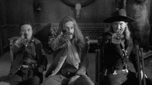 ... while three bounty hunters (Eugene Byrd, Michael Wincott, Lance Henriksen) pursue Blake in Jim Jarmusch's Dead Man (1995)