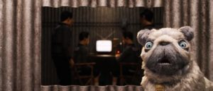 Oracle provides Atari with important information gleaned from television in Wes Anderson's Isle of Dogs (2018)