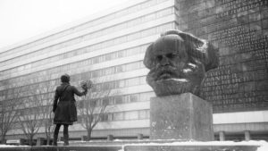 Co-director Petra Epperlein confronts the 40-ton bust of Karl Marx in Chemnitz in Petra Epperlein and Michael Tucker's Karl Marx City (2016)
