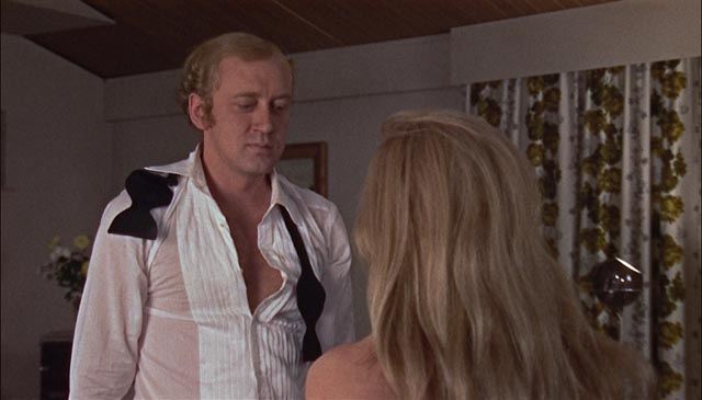 Mick Marler (Nicol Williamson) about to get rough with his wife (Ann Bell) in Jack Gold's The Reckoning (1969)