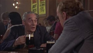 Mick gets the story behind his father's death from the old man's friend in Jack Gold's The Reckoning (1969)