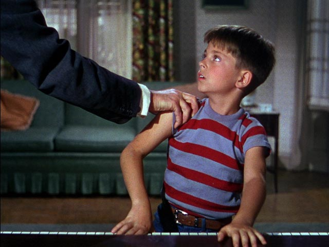 Young Bart Collins (Tommy Rettig) resists the oppression of Dr. Terwilliker (Hans Conried) in Dr. Seuss' The 5000 Fingers of Dr. T (1953)