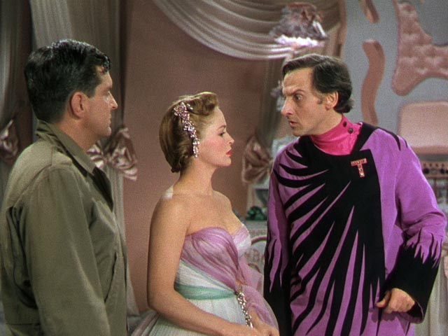 Mr. Zabladowski (Peter Lind Hayes) and Heloise Collins (Mary Healy) confront the musical despot Dr. Terwilliker (Hans Conried) in Dr. Seuss' The 5000 Fingers of Dr. T (1953)