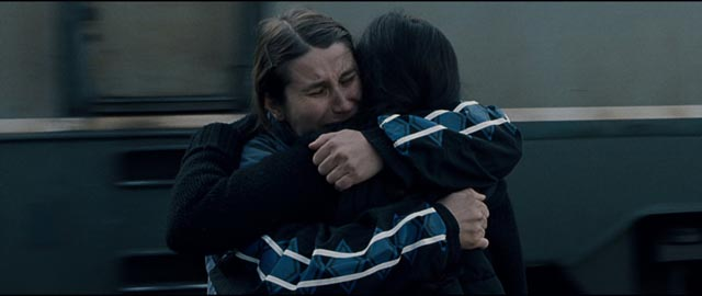 Returning from Germany, Alina (Cristina Flutur) clings desperately to her childhood companion Voichita (Cosmina Stratan) in Cristian Mungiu's Beyond the Hills (2012)
