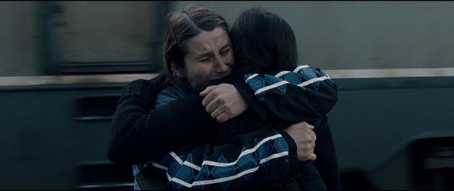 Returning from Germany, Alina (Cristina Flutur) clings desperately to her childhood companion Voichita (Cosmina Stratan) in Cristian Mungiu's Beyond the Hills (2012)