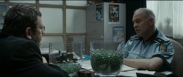 Romeo (Adrian Titieni) gets advice from an old friend, the chief of police (Vlad Ivanov) in Cristian Mungiu's Graduation (2016)
