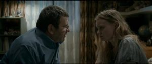 Romeo (Adrian Titieni) tries to explain to Eliza (Maria Dragus) that she must cheat just a little on her exams in Cristian Mungiu's Graduation (2016)