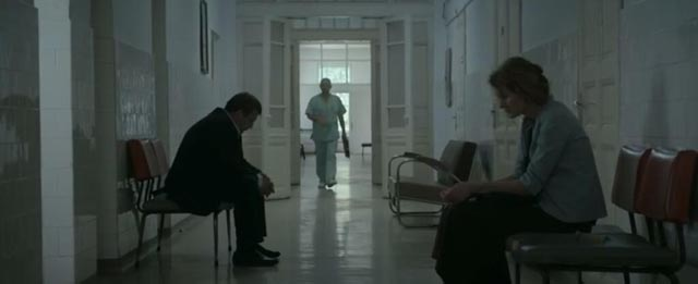 The distance between Romeo (Adrian Titieni) and Magda (Lia Bugnar) is apparent as they wait at the hospital in Cristian Mungiu's Graduation (2016)