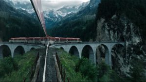 The train carries Lockhart into an unreal landscape in Gore Verbinski's A Cure for Wellness (2916)