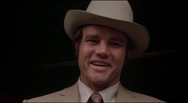 Cheerful hitman Molly (Joe Don Baker) tracks the gang relentlessly in Don Siegel's Charley Varrick (1973)