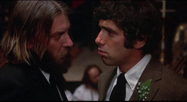 Rev. Dupas (Donald Sutherland) takes a laissez-faire attitude towards religious belief and ritual in Jules Feiffer's & Alan Arkin's Little Murders (1971)