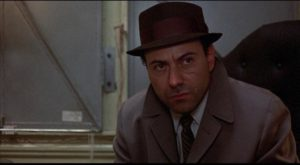 Paranoid detective Practice (Alan Arkin) sees mysterious patterns in the non-stop violence in Jules Feiffer's & Alan Arkin's Little Murders (1971)