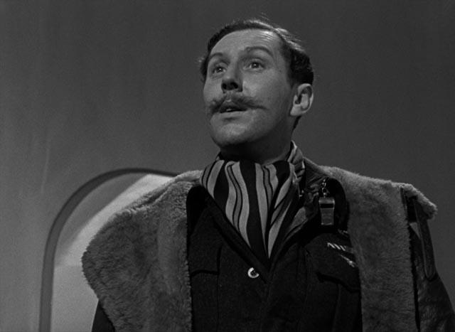 Crewman Bob Trubshaw (Robert Coote) wonders what's delaying Peter's arrival in Heaven in Michael Powell and Emeric Pressburger's A Matter of Life and Death (1946)