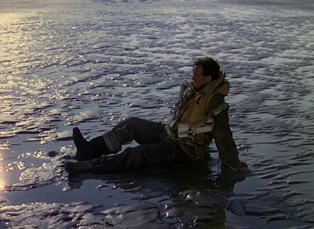 Squadron Leader Peter Carter (David Niven) wakes on a beach which may be Heaven in Michael Powell and Emeric Pressburger's A Matter of Life and Death (1946)