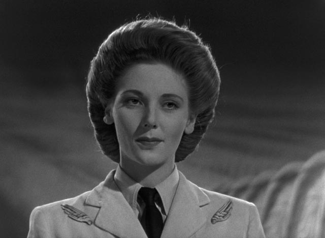 ... and the Heavenly receptionist (Kathleen Byron) informs him that mistakes are never made here in Michael Powell and Emeric Pressburger's A Matter of Life and Death (1946)