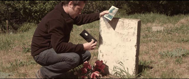 Michael receives messages via various media artifacts in Justin Benson and Aaron Moorhead's Reolution (2012)