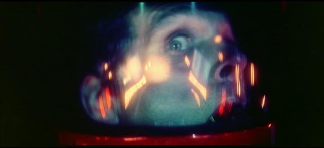 Bowman (Keir Dullea) seems to twist with fear and pain as he is dragged through the Stargate in Stanley Kubrisk's 2001: A Space Odyssey (1968)