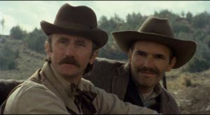Sheriff Morris (Timothy Scott) and Deputy Boone Choate (Tom Bower) are already inclined to distrust ...