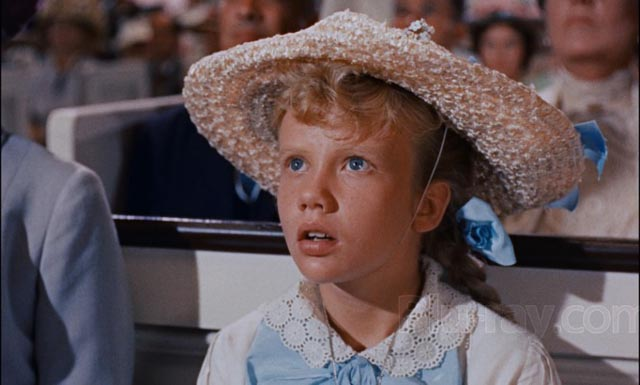 Hayley Mills as Pollyanna gradually becomes aware of the flaws of adults