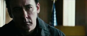 John Cusack as a burnt-out American agent trying to protect a civilian operative in Kasper Barfoed's The Numbers Station (2013)