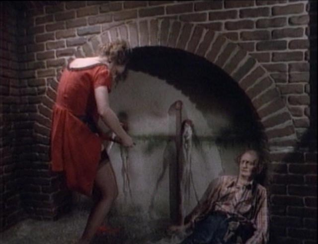Wendy (Bonnie Beck) faces imminent drowning in an underground trap in D.B. Benedikt's Beyond the Seventh Door (1986)