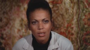 Ivory Stone as Dr. Winifred Walker, the vet's concerned fiancee in William A Levey's Blackenstein (1973)