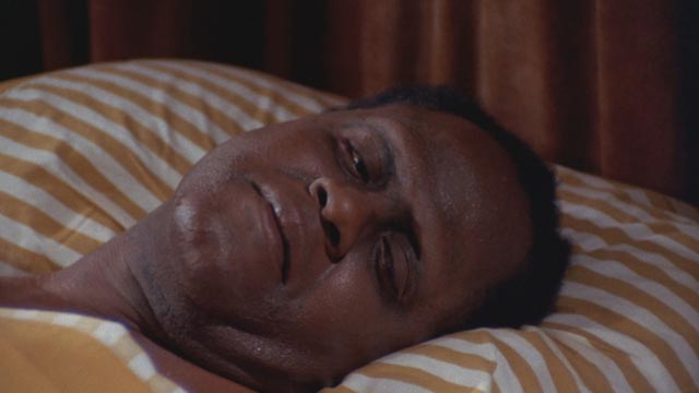 Vietnam vet Eddie Turner (Joe De Sue), helpless without limbs in a VA hospital in William A. Levey's Blackenstein (1973)