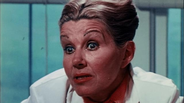 Dr. Geraldine Masters (Anne MacAdams) isn't quite what she seems in S.F. Brownrigg's Don't Look in the Basement (1972)