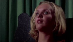 Trauma catches up with Amanda (Susan Bracken) at the end of S.F. Brownrigg's Don't Open the Door (1974)