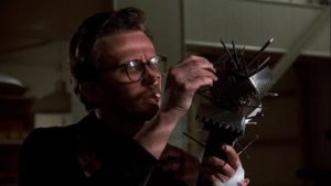 Corporate executive Bart Hughes (Peter Weller) is driven to extremes by a rodent in George Pan Cosmatos' Of Unknown Origin (1983)