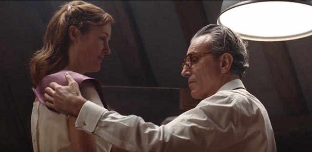 Reynolds Woodcock (Daniel Day-Lewis) is interested in the clothes, not in Alma (Vicky Krieps), the woman wearing them, in Paul Thomas Anderson's Phantom Thread (2017)