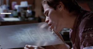 Forger Eric Masters (Willem Dafoe) examines freshly-made plates in William Friedkin's To Live and Die in L.A. (1985)
