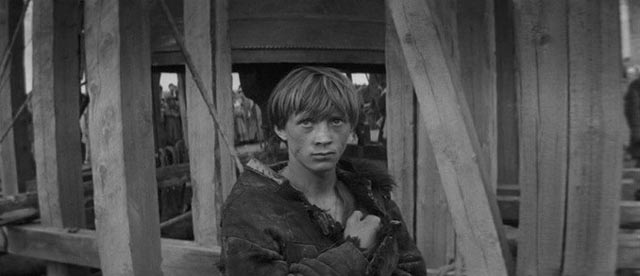 Boriska (Nikolay Burlyaev) is found alone in a village destroyed by plague in Andrei Tarkovsky's Andrei Rublev (1966)