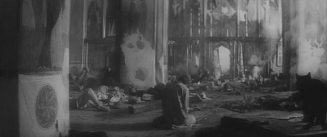 Andrei (Anatoliy Solonitsyn) faces despair inside the cathedral surrounded by the massacred inhabitants of Vladimir in Andrei Tarkovsky's Andrei Rublev (1966)