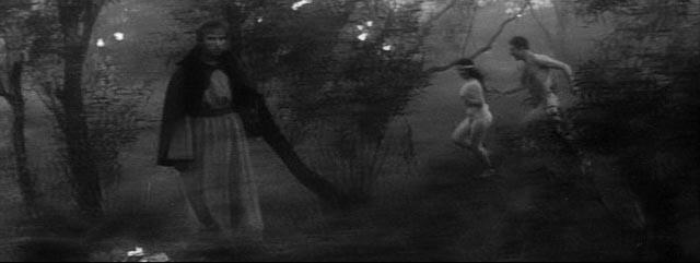 Andrei (Anatoliy Solonitsun)witnesses a joyous pagan celebration in Andrei Tarkovsky's Andrei Rublev (1966)